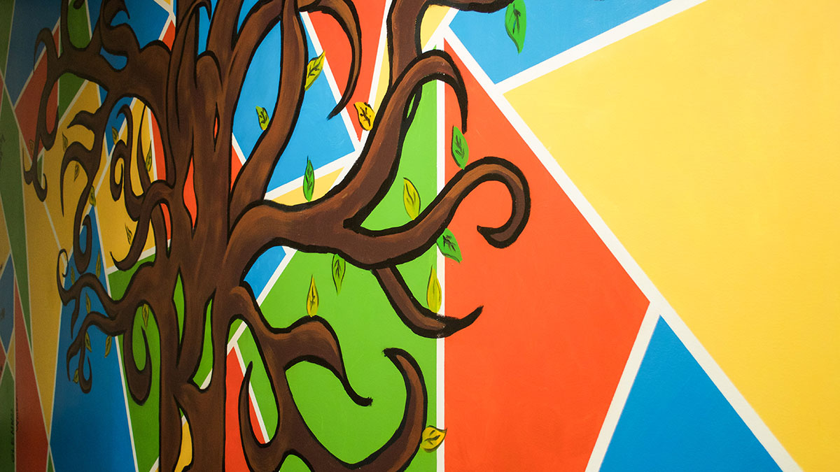 New mural branches across walls of the education clinic for Educational mural