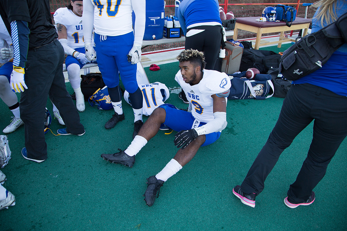 UBC's Malcom Lee receiving trainers attention on the sidelines.