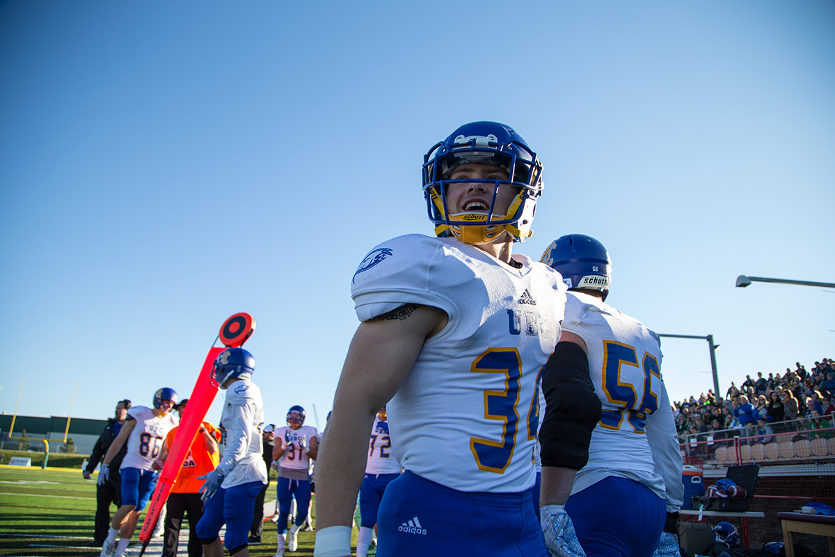 UBC running back Dwayne Neustaeter enjoys the show from sidelines.