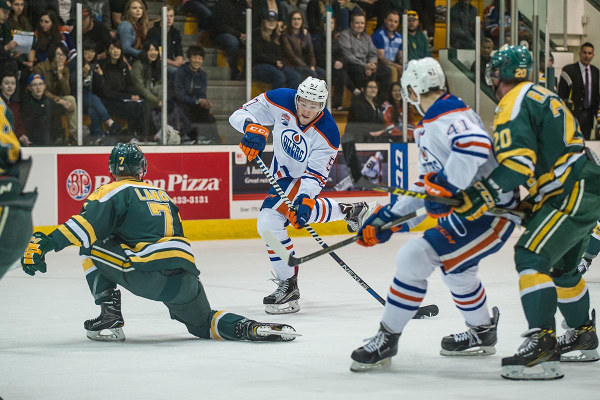 Collin Shirley, from Saskatoon, fires a shot at Bears defensemen Sawyer Lange.
