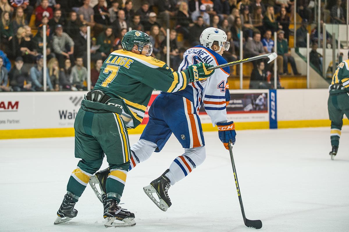 Lange checks Oilers Rookies forward Jaedon Descheneau.