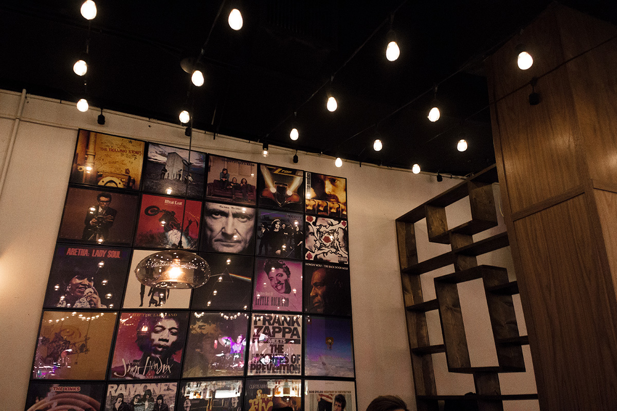 The dining lounge is decorated with collages consisting of some of the most iconic album covers of all time.