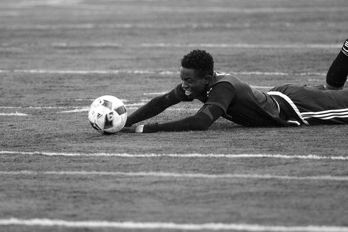 Tolu Esan dives for the ball